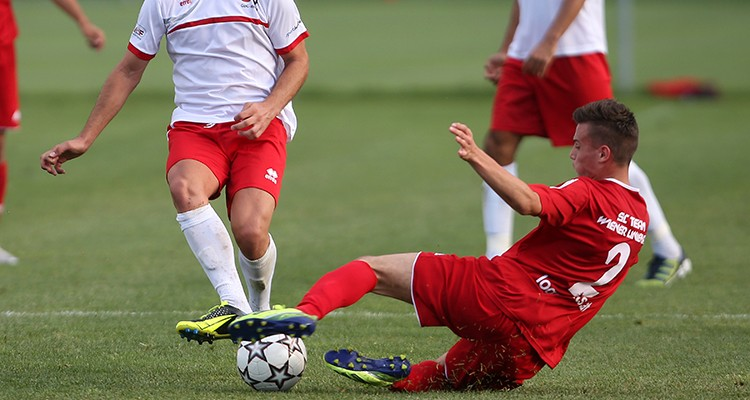 STEINBRUNN,AUSTRIA,23.JUL.14 - SOCCER - VdF-Team der vertragslosen Fussballer vs Team Wiener Linien, test match. Image shows Lumbardh Salihu (VdF) and Alberin Kokollari (TWL). Photo: GEPA pictures/ Mario Kneisl