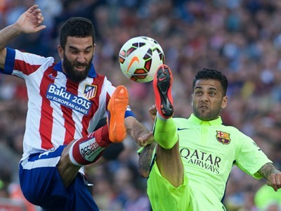 MADRID,SPAIN,17.MAY.15 - SOCCER - Primera Division, Atletico Madrid vs FC Barcelona. Image shows Arda Turan (Atletico) and Dani Alves (Barcelona). Photo: GEPA pictures/ Cordon Press/ Gregorio Lopez - ATTENTION - COPYRIGHT FOR AUSTRIAN CLIENTS ONLY